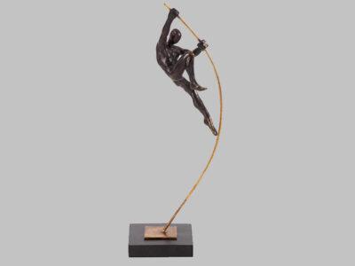 Pole vaulter statue jumping